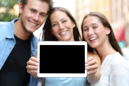 three people blurred out holding a black picture