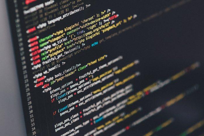 Alt-text in HTML code black computer screen