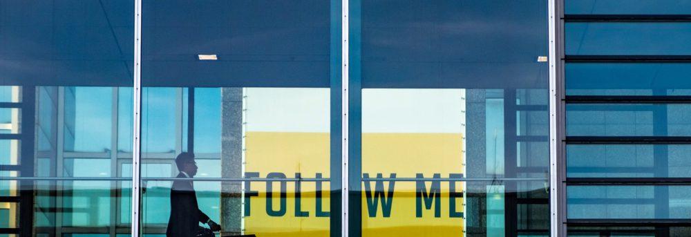 Follow me yellow sign